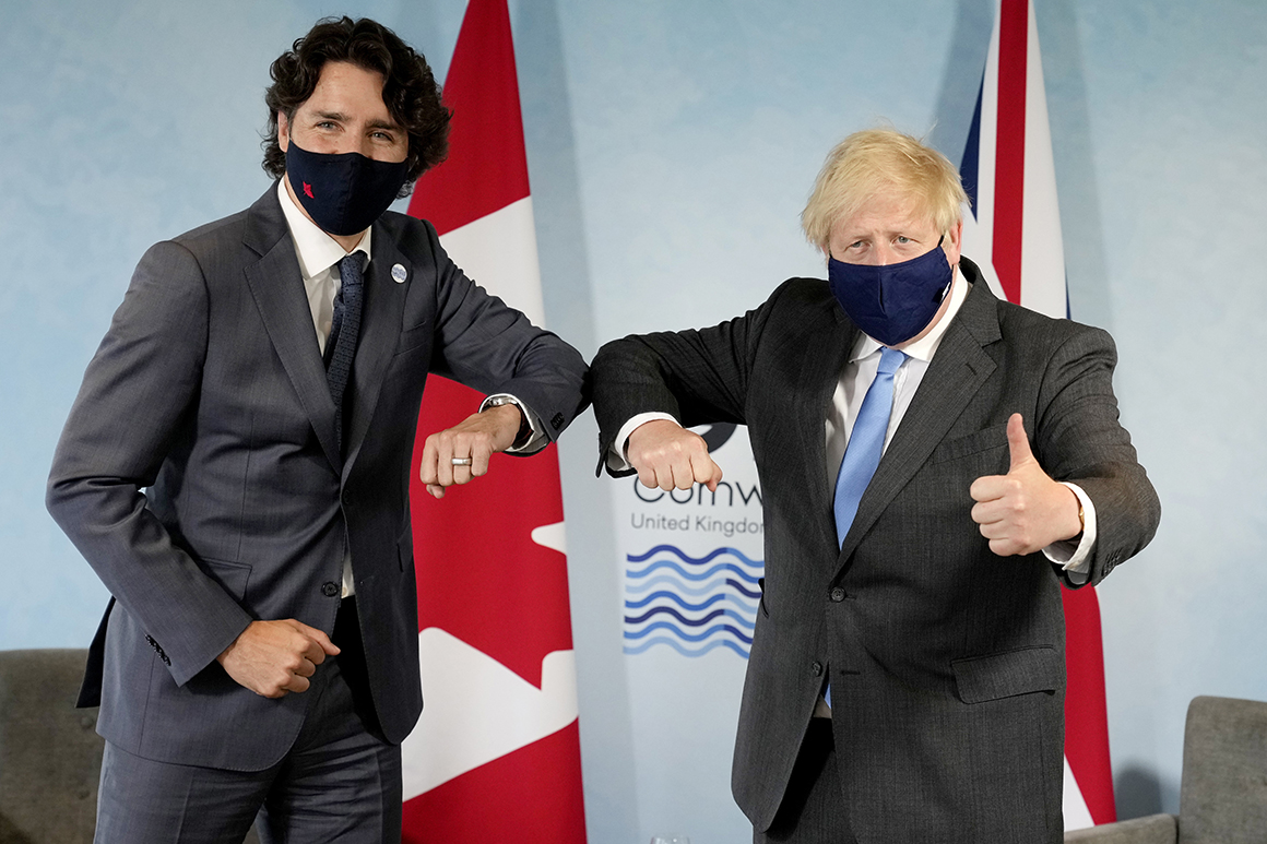 British Prime Minister Boris Johnson, right, greets Canadian Prime Minister Justin Trudeau prior to a bilateral meeting during the G-7 meeting in England on June 11.