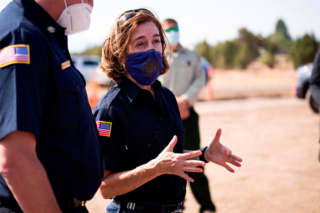 In southeastern Oregon, two new wildfires started by lightning Thursday near the California border  -- forcing Gov. Kate Brown (right) to declare a state of emergency.